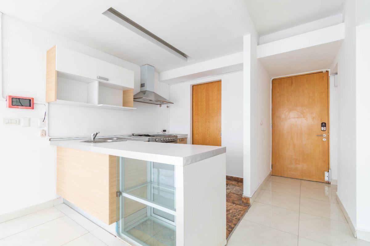 5 de 19: Cocina abierta y área de lavado