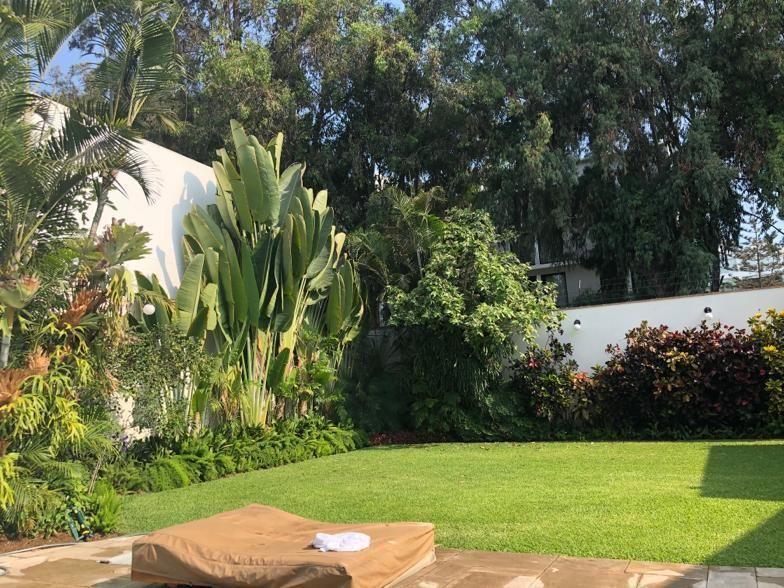 9 de 12: Hermoso Jardín, gran terraza y piscina con vista Boulevard