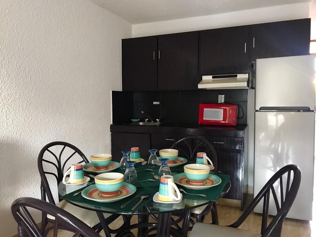 10 de 16: Cocina de habitación