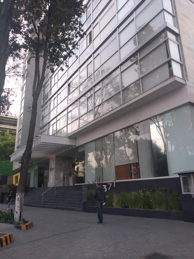 1 de 11: Entrada de Edificio
