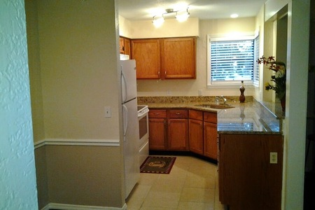 Cute 1/1 Condo with Wood Floors and Pool View for Rent in front of