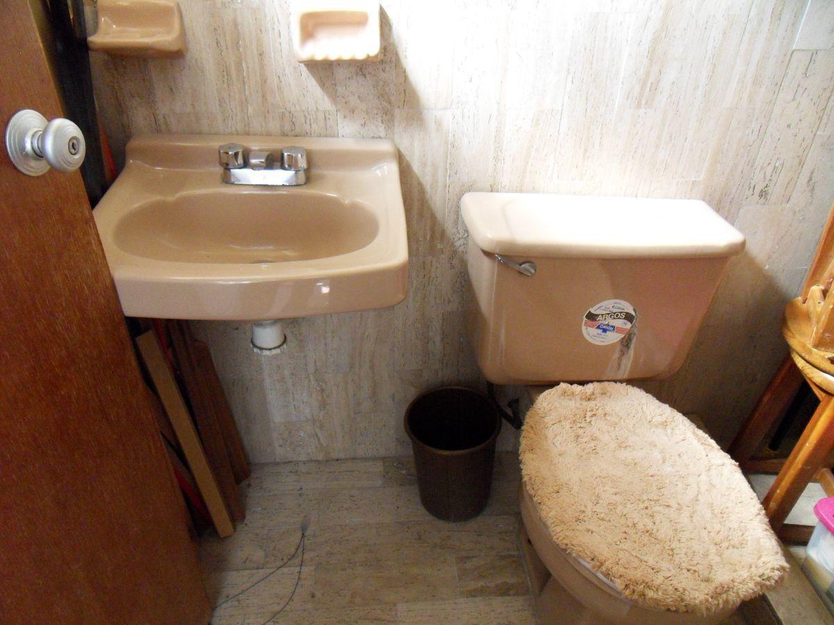 26 de 27: Baño en el cuarto de servicio