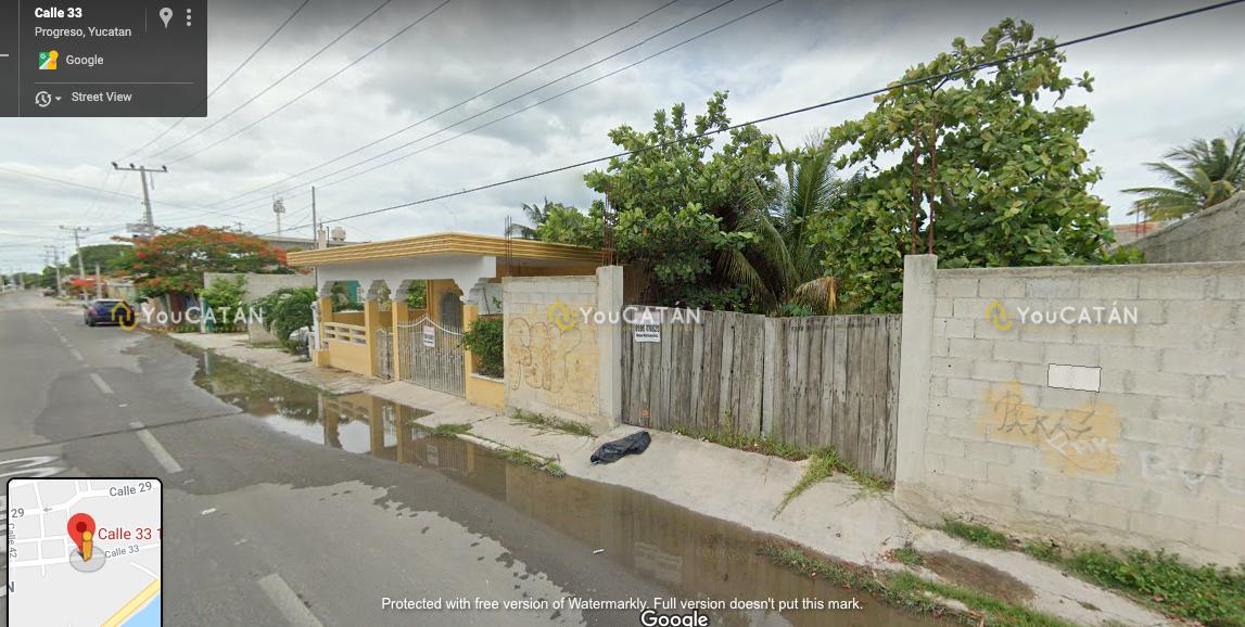 8 de 12: Vista frontal de la propiedad por calle 33