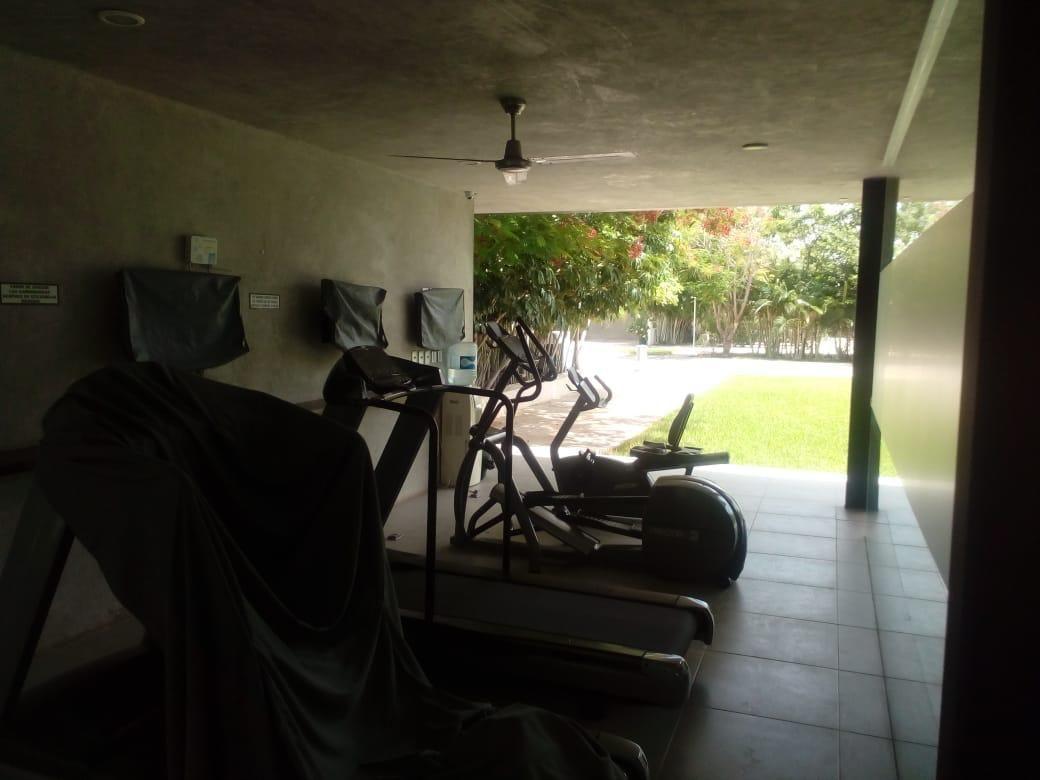 4 de 24: área de gimnasio casa club