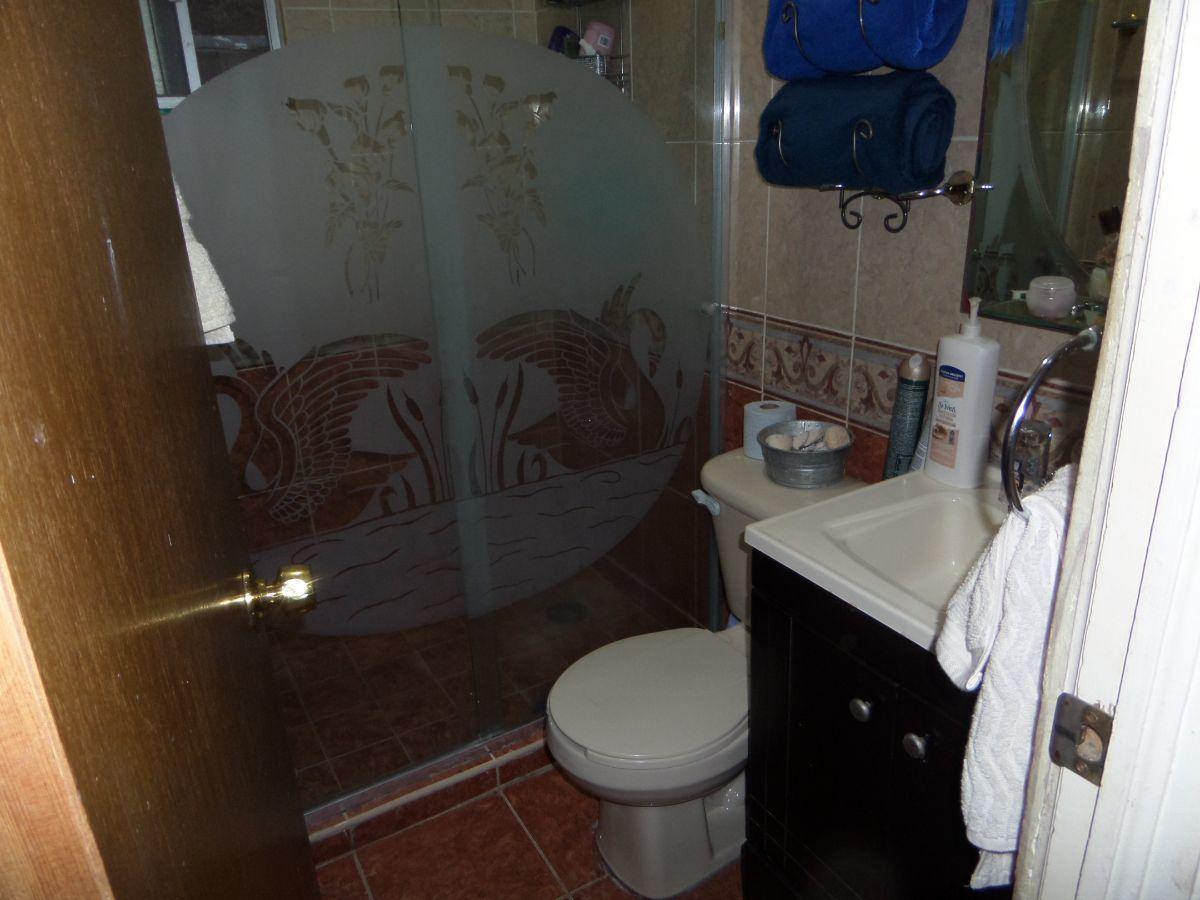 20 de 21: Baño con cristal templado