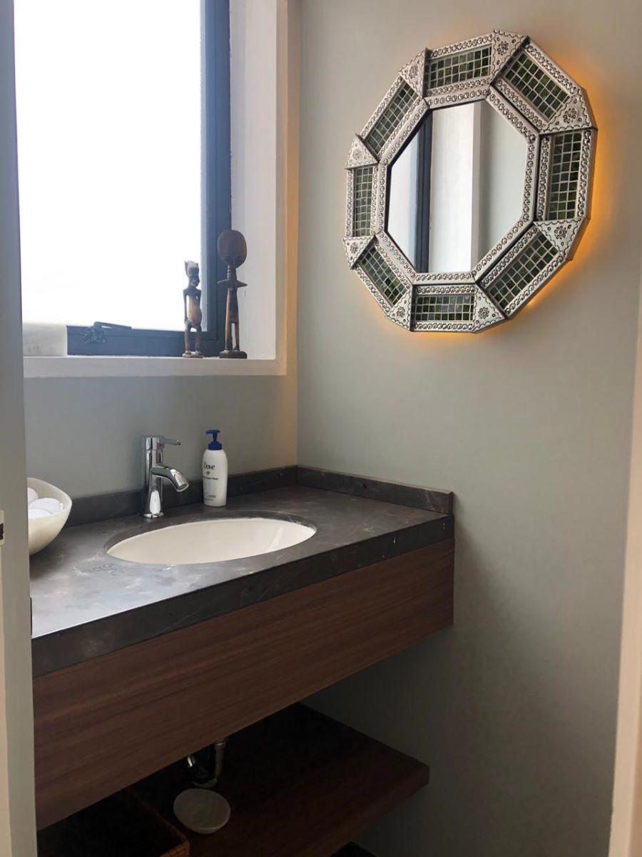 13 de 38: Medio baño para visitas