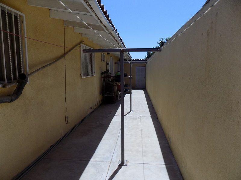 34 de 50: PASILLO DE SERVICIO EN LA PARTE DE ATRÁS