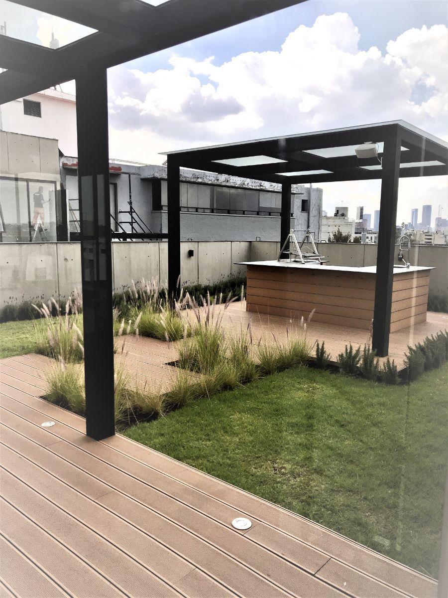 15 de 19: Roof Garden con asadores