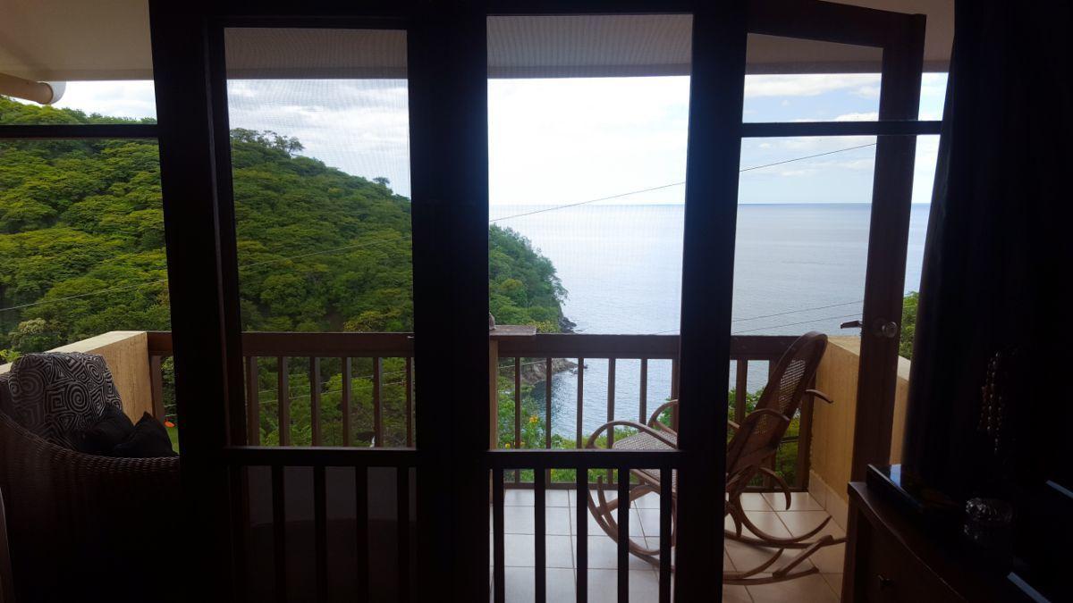 14 of 20: Main Bedroom with balcony Ocean View