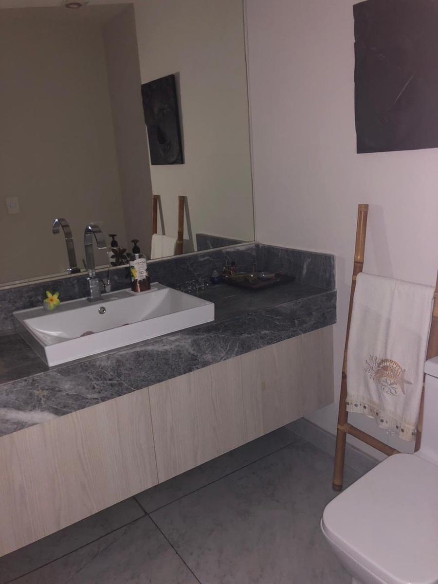 13 de 18: Baño de visitas