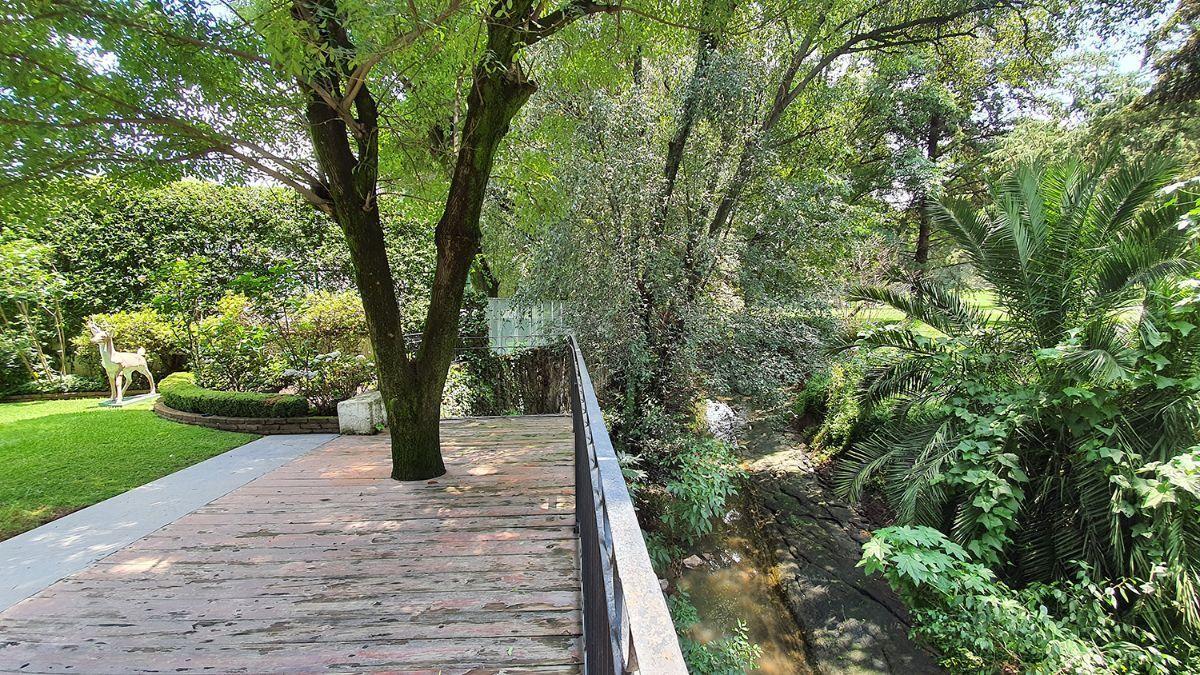 9 de 20: Terraza y jardin con vista al green