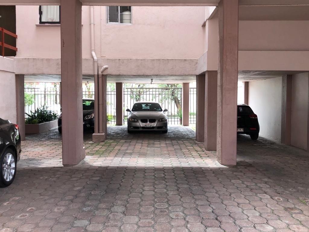 26 de 31: Estacionamiento