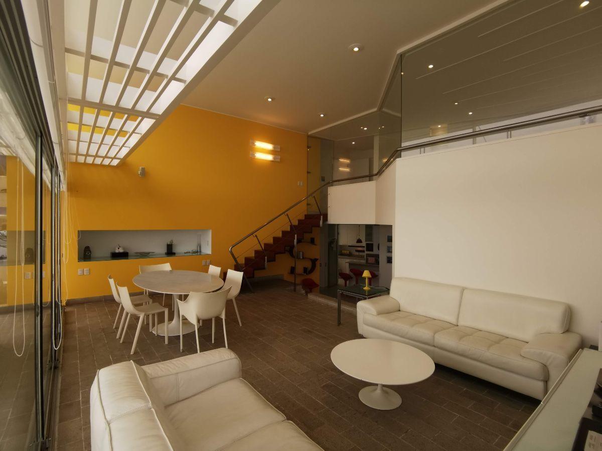 5 de 33: Área social con techo de doble altura y espectacular vista