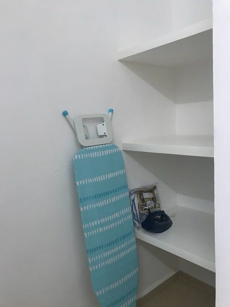 8 de 11: 07) LINENS CLOSET, CLOTHES IRON AND IRONING BOARD