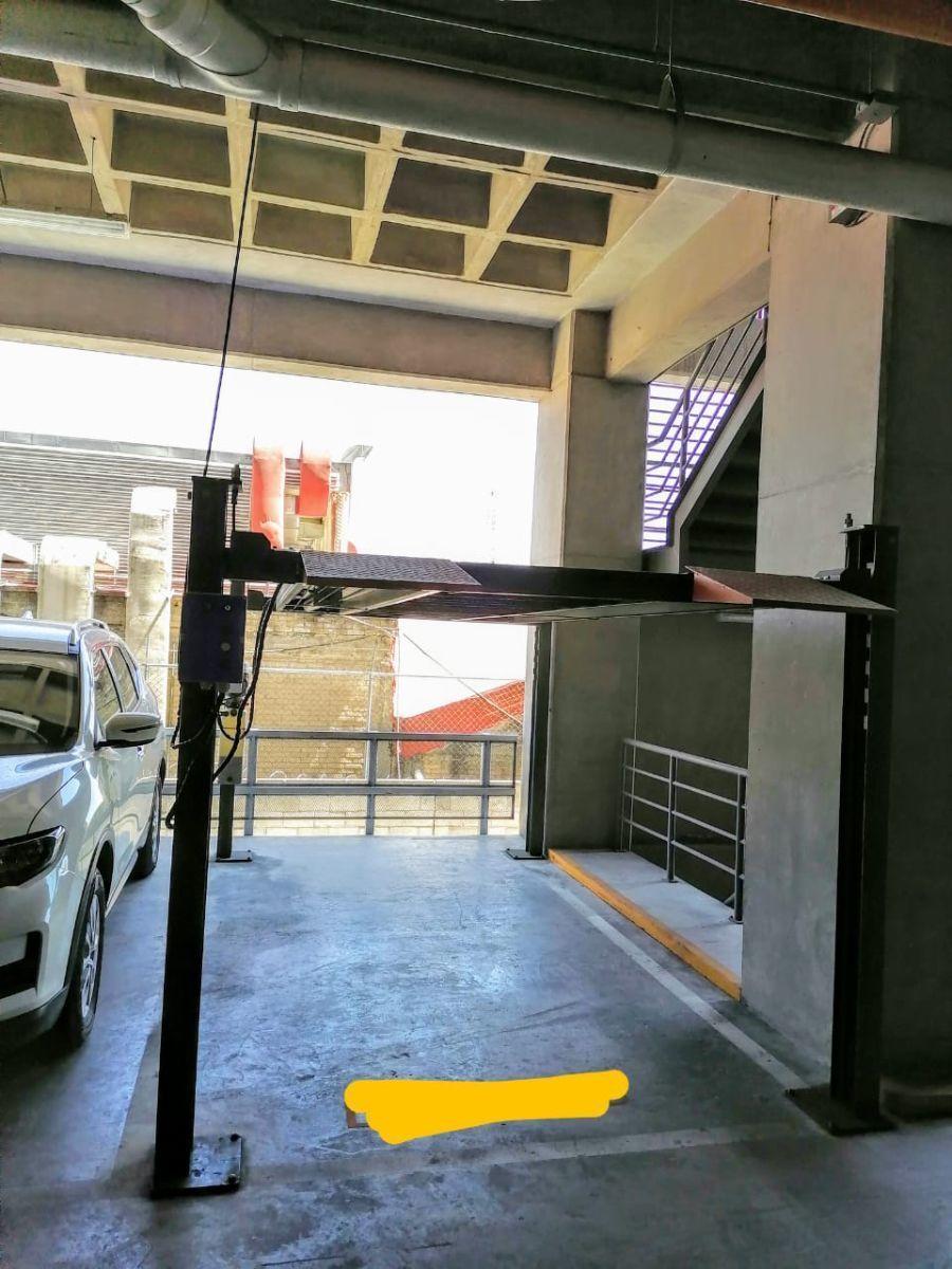 14 de 16: Estacionamiento con Eleva Autos