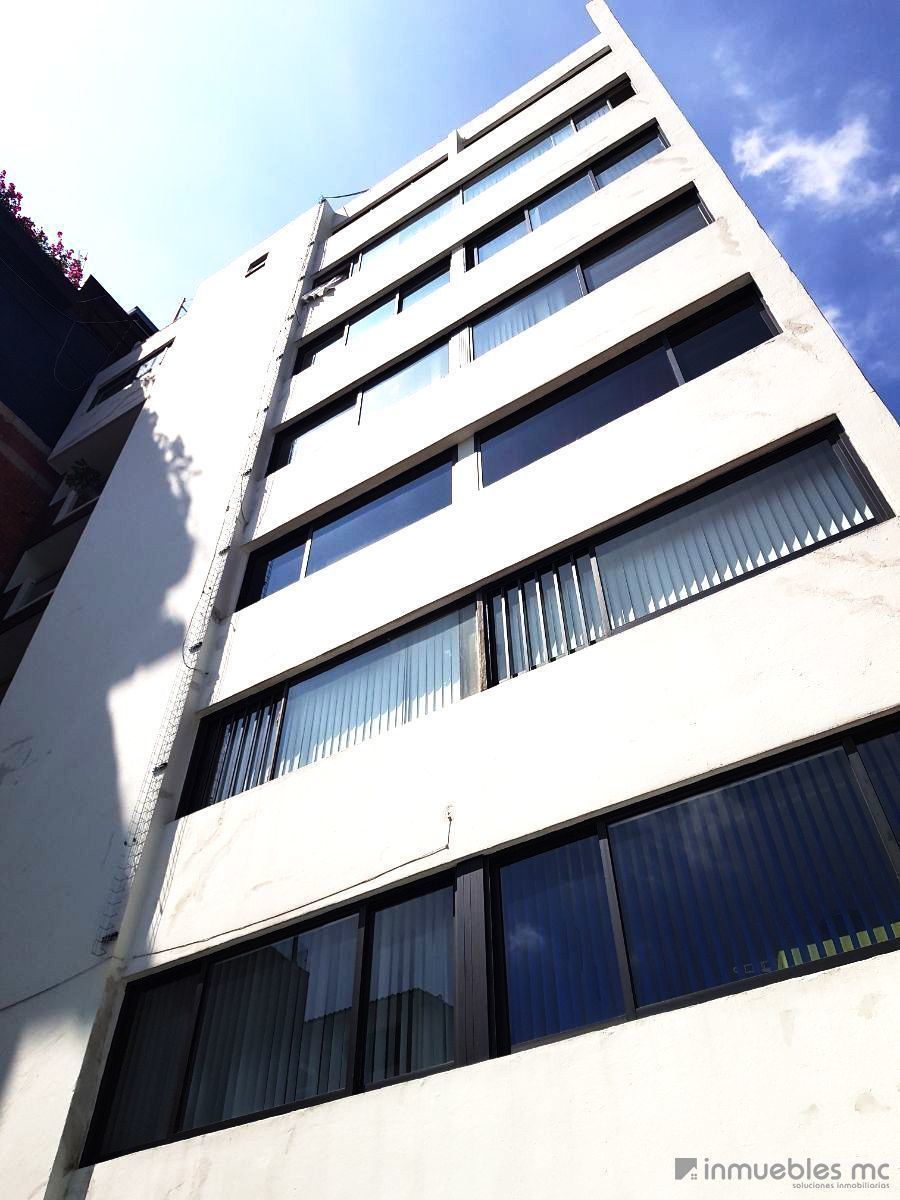 1 de 22: Fachada posterior del edificio