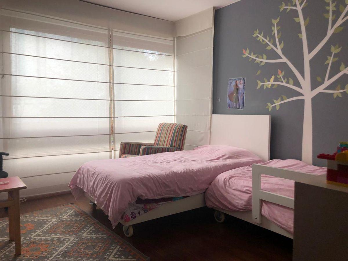 13 de 16: Dormitorio secundario.