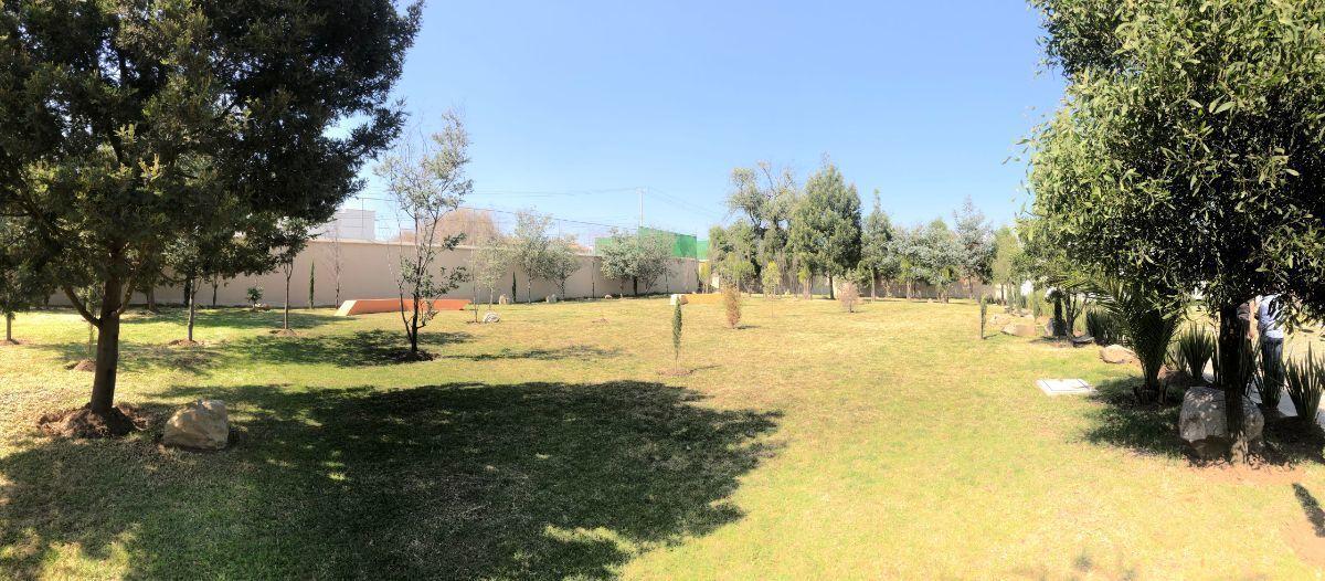 19 de 21: Jardín
