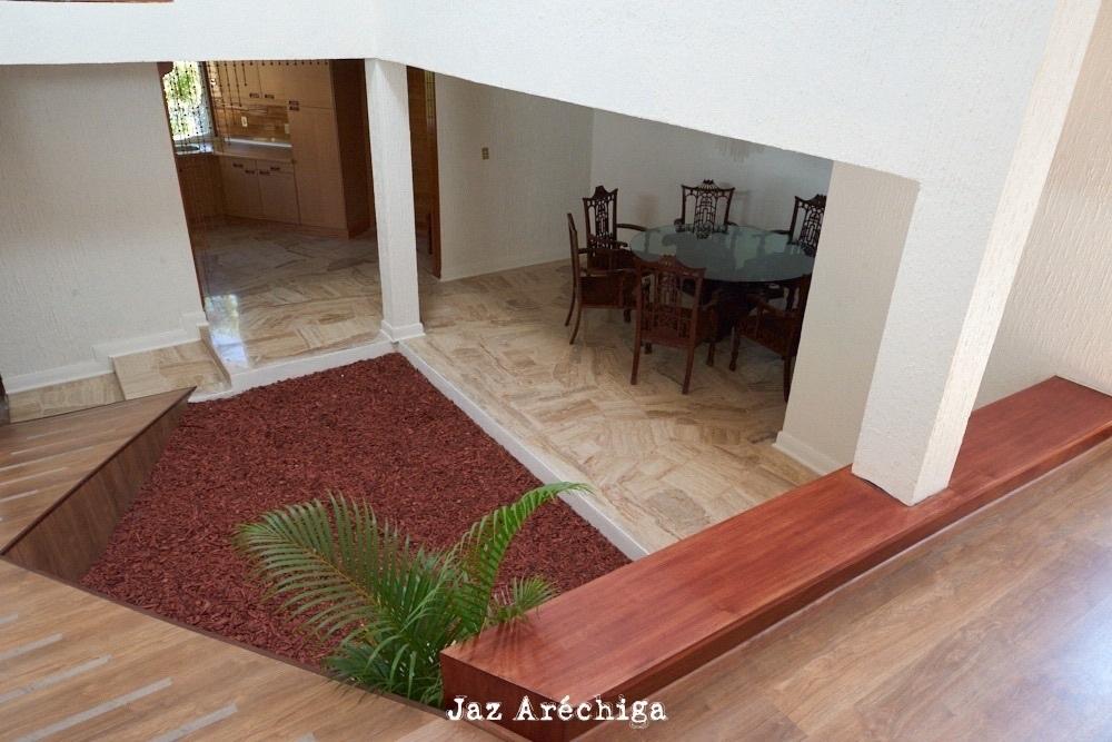 7 de 24: Vista desde la sala al comedor y cocina