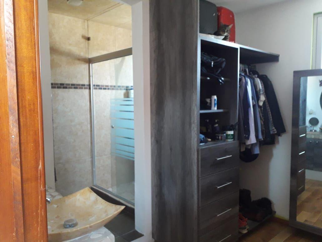 20 de 34: Baño principal con vestidor