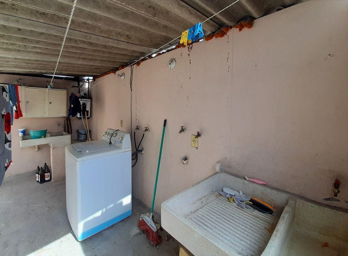 13 de 16: área de lavado techada