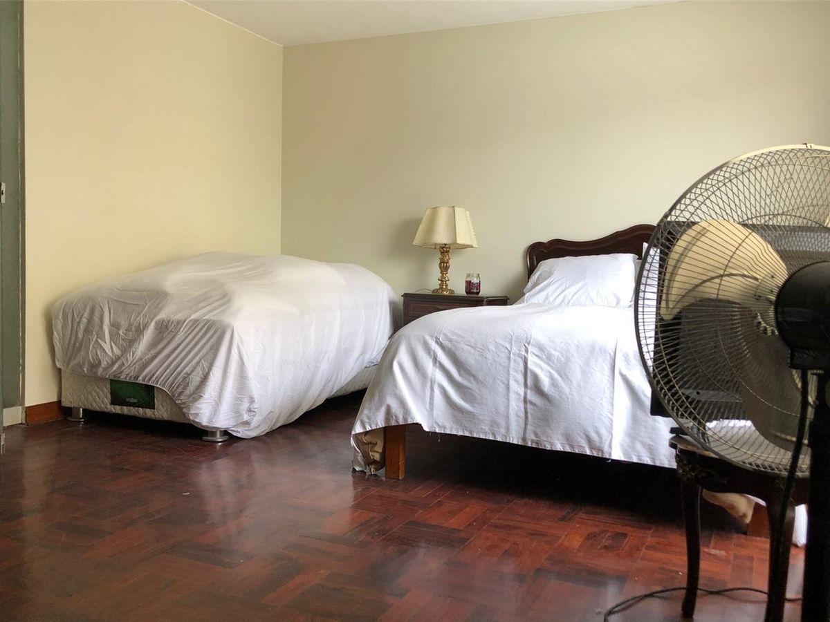 9 de 12: Dormitorio secundario.