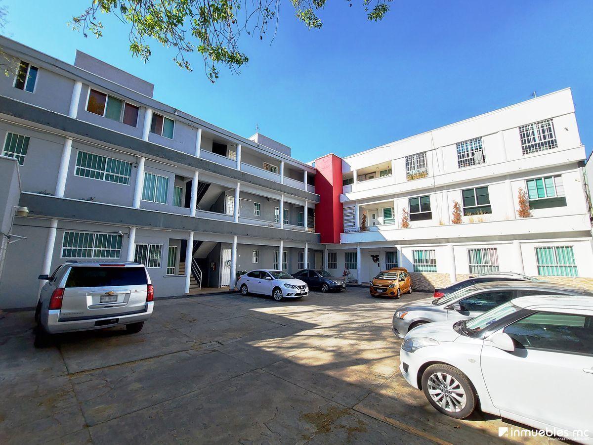 16 de 19: Unidad Habitacional vista desde el estacionamiento