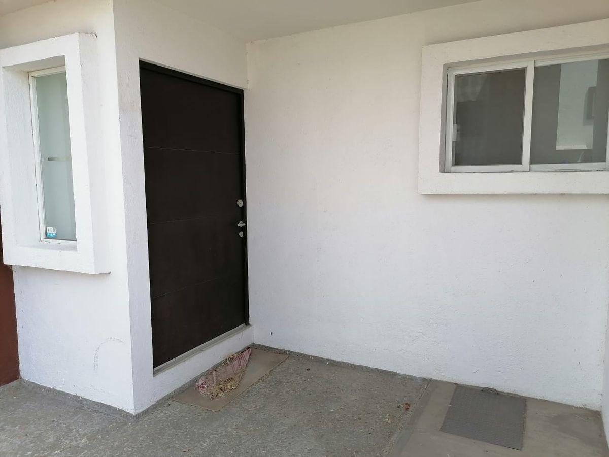2 de 18: acceso a la casa