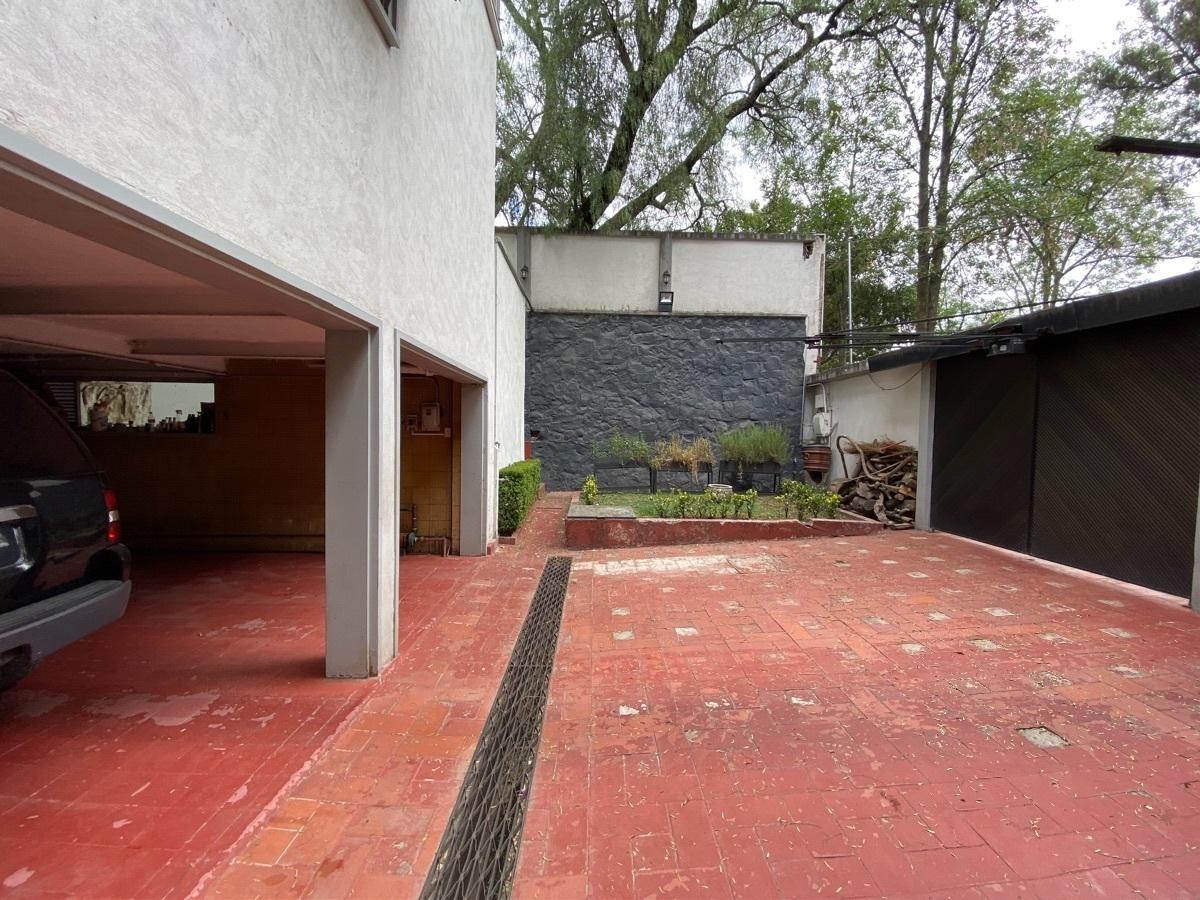 19 de 28: Garage semi abierto