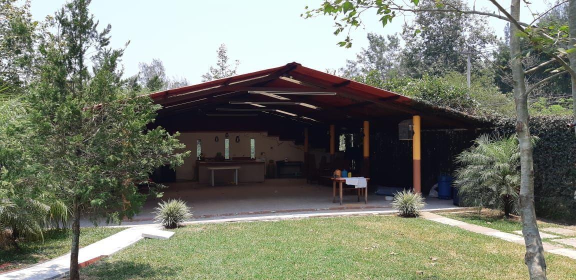 6 de 15: PALAPA Y AREA DE JARDIN