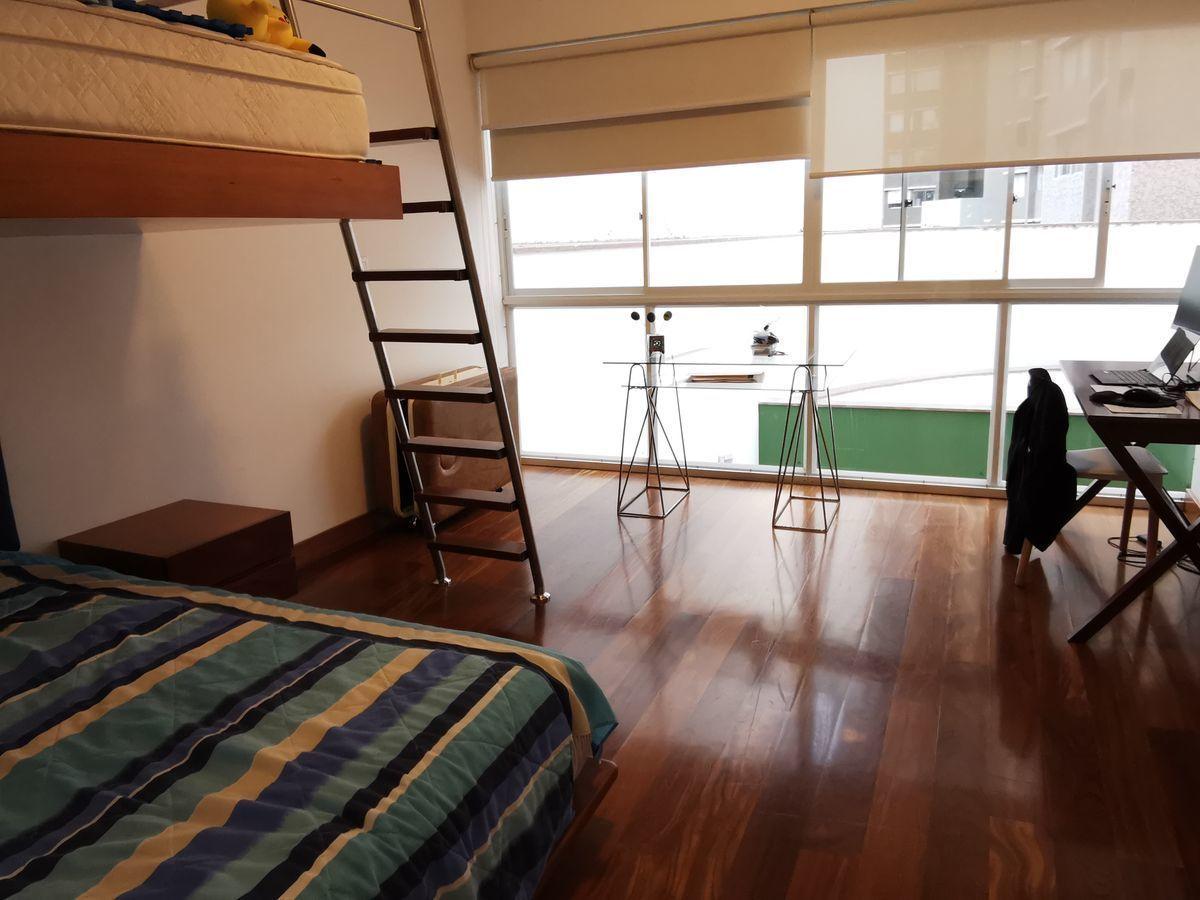 27 de 41: Dormitorio secundario amplio con baño incorporado