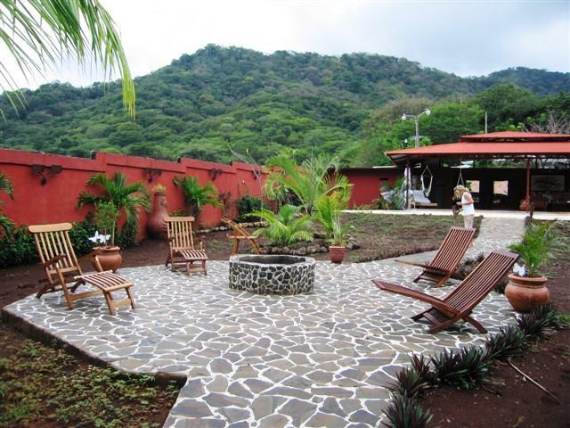 1 of 45: Slatted walkways with fire pit and teak furniture