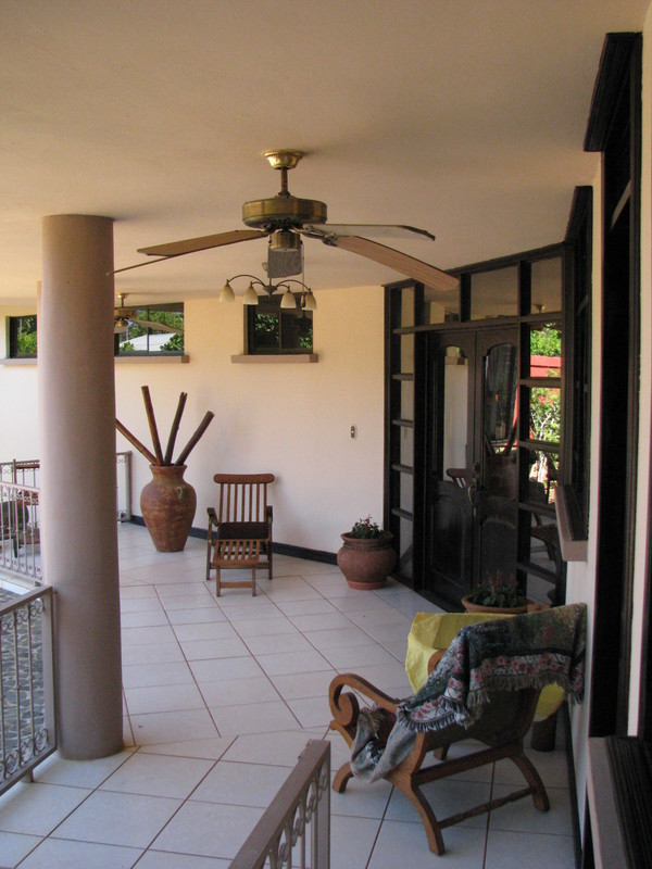 6 of 45: Front  Terrace featuring teak furniture