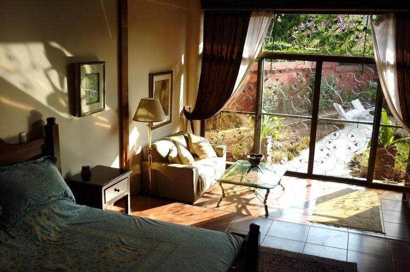 34 of 45: Master bedroom salon with sliding doors to backyard