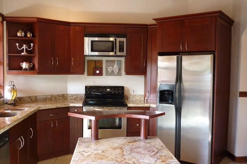 31 of 45: Kitchen featuring granite and stainless steel appliances