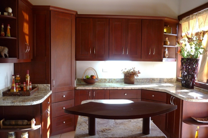 32 of 45: Kitchen with bright lighting and center Island