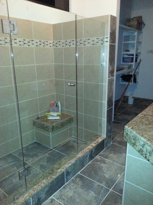 37 of 45: Master bathroom featuring granite counters & shower seat