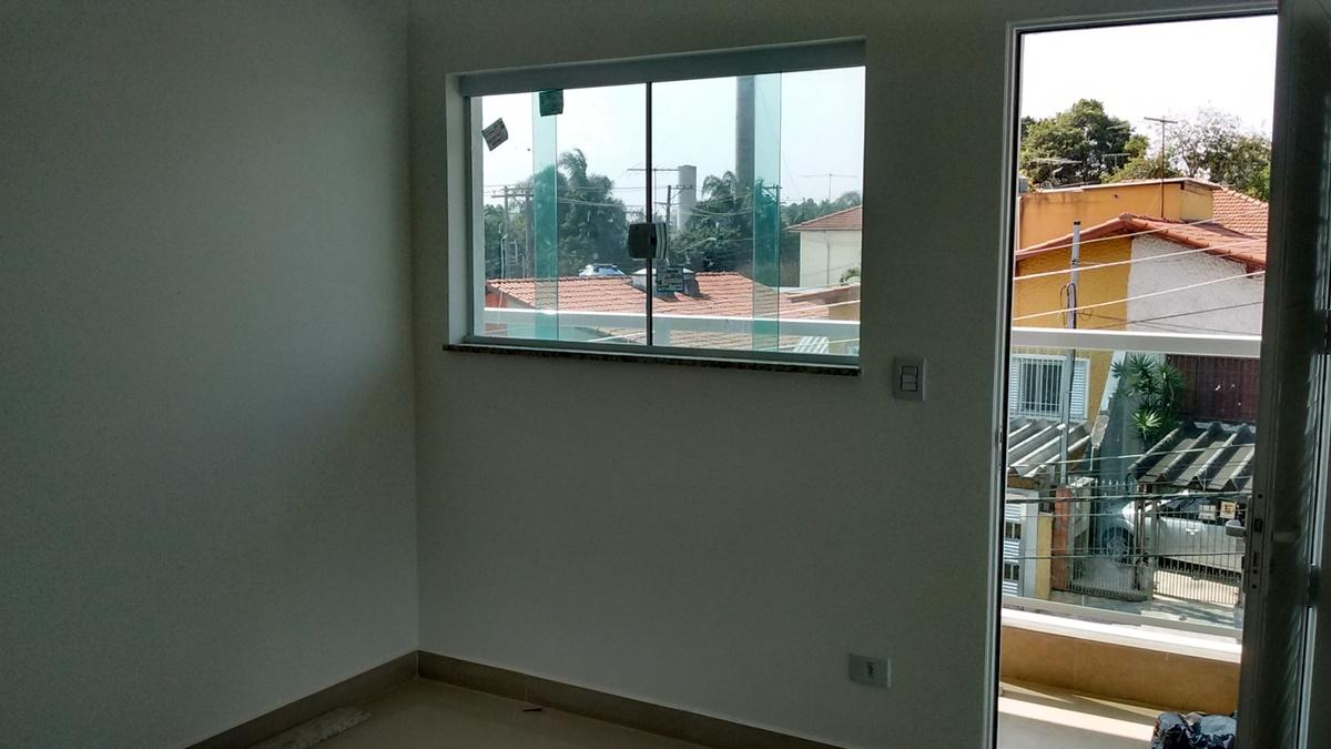 6 de 21: Sala e Porta de Acesso ao Apartamento