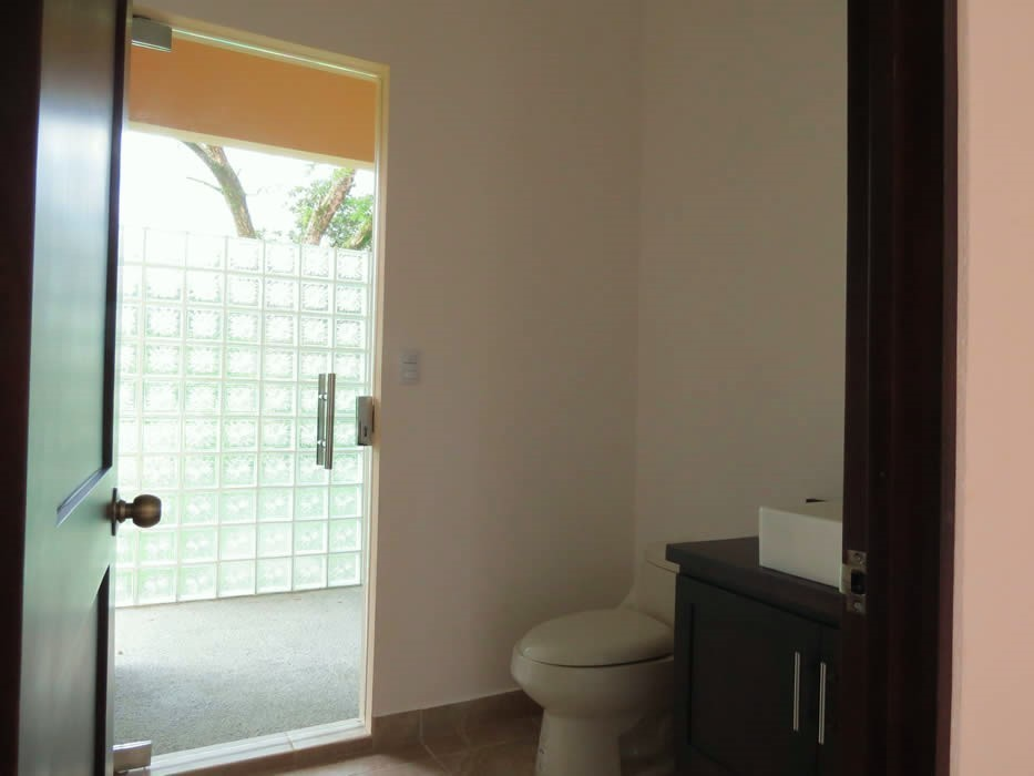 14 of 50: Bathroom #2 towards outdoor shower.