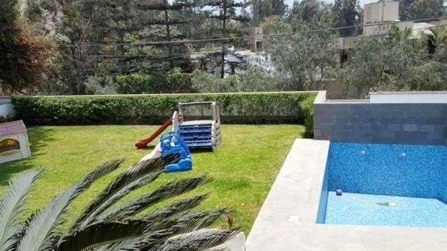 14 de 16: piscina y jardin