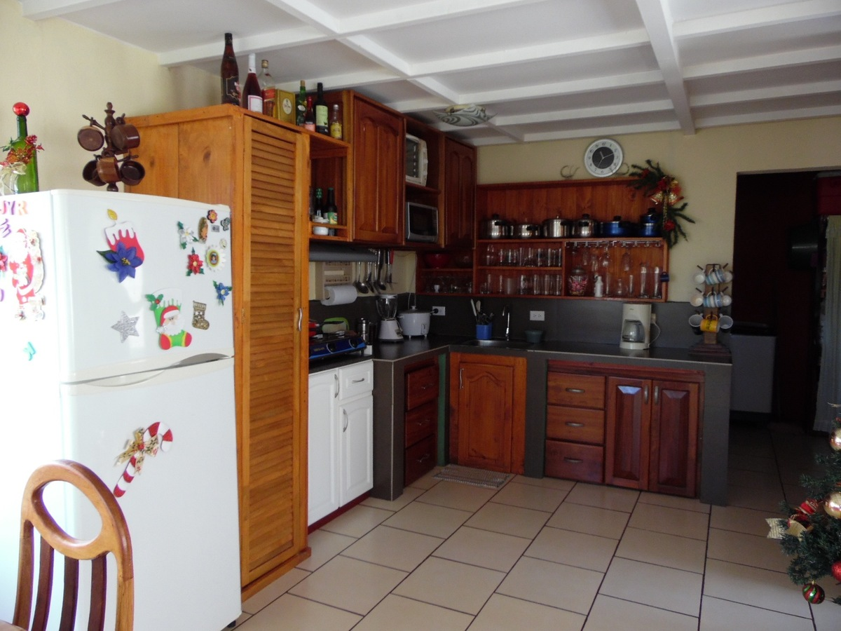 5 of 12: Spacious kitchen in immaculate condition