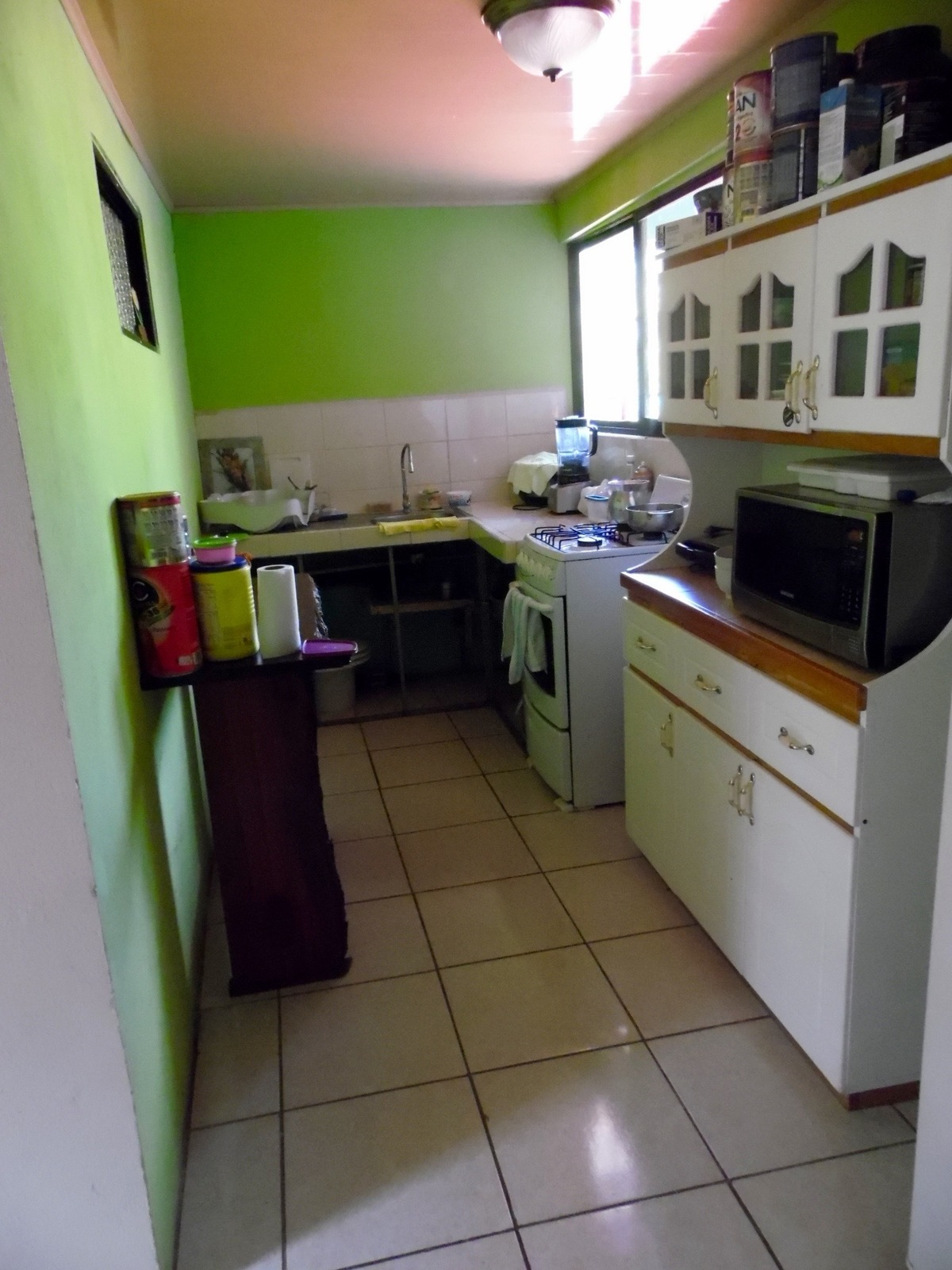 4 of 6: Private kitchen upstairs for owners or rental.