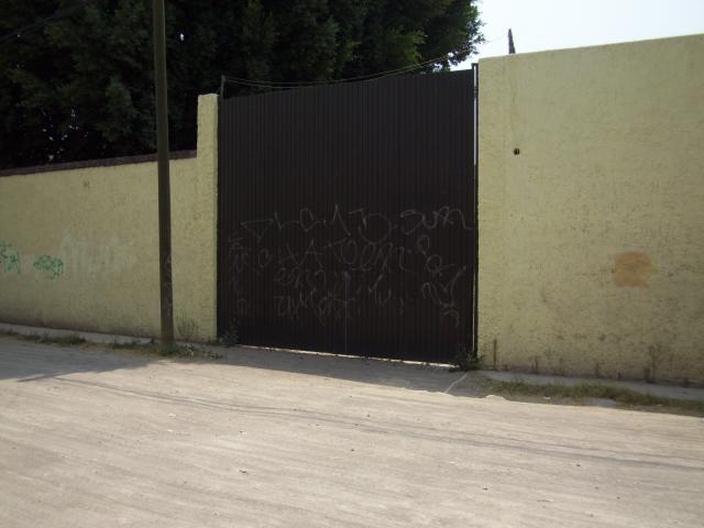 16 de 16: Portón Lateral