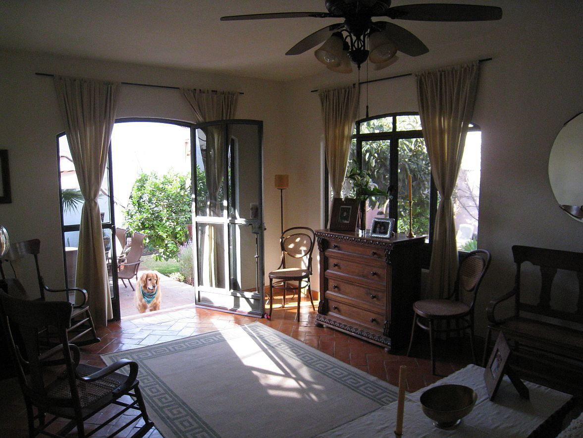 2 of 11: Living room with Saltillo tile floors