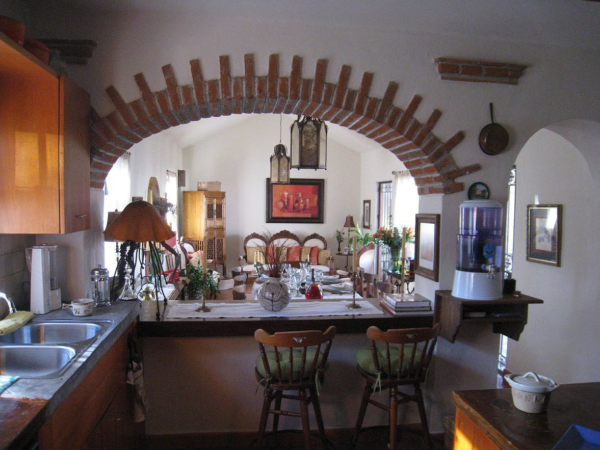 3 of 11: Kitchen and dining room Saltillo tile floors