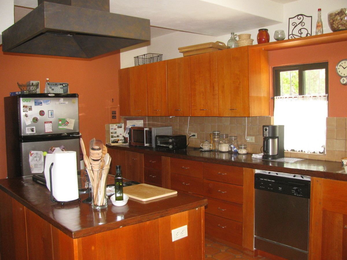 11 of 11: Kitchen with hardwood cabinets