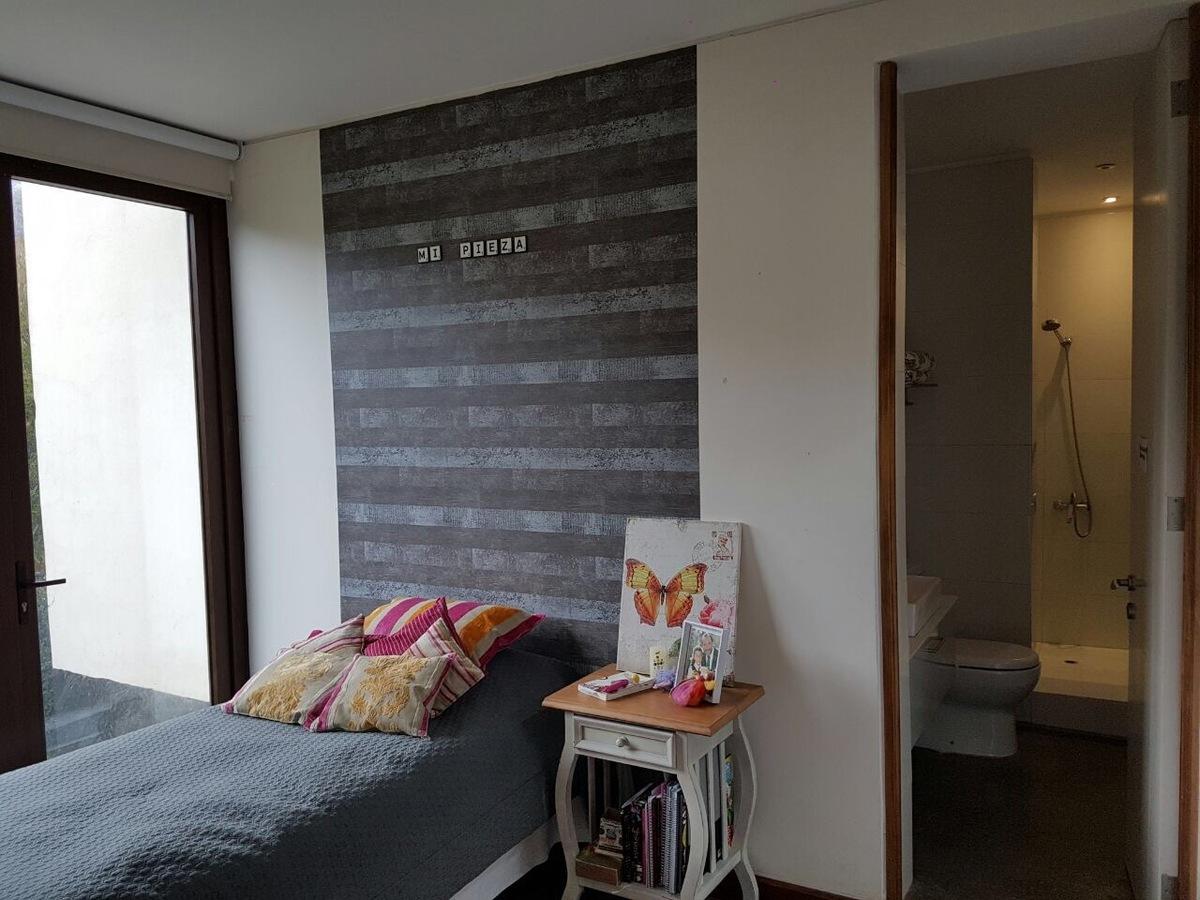 12 de 12: Dormitorio en suite.