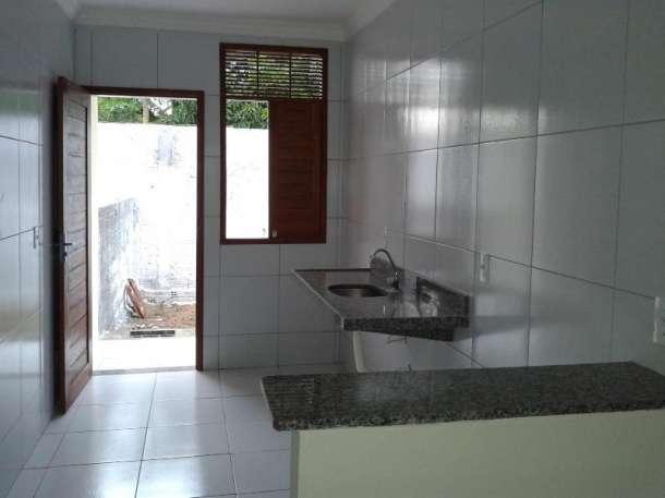 6 de 14: vista da sala para a cozinha tipo americana área serviço