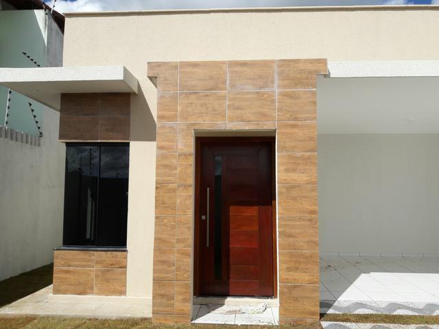 3 de 16: entrada principal da casa Porta jatobá