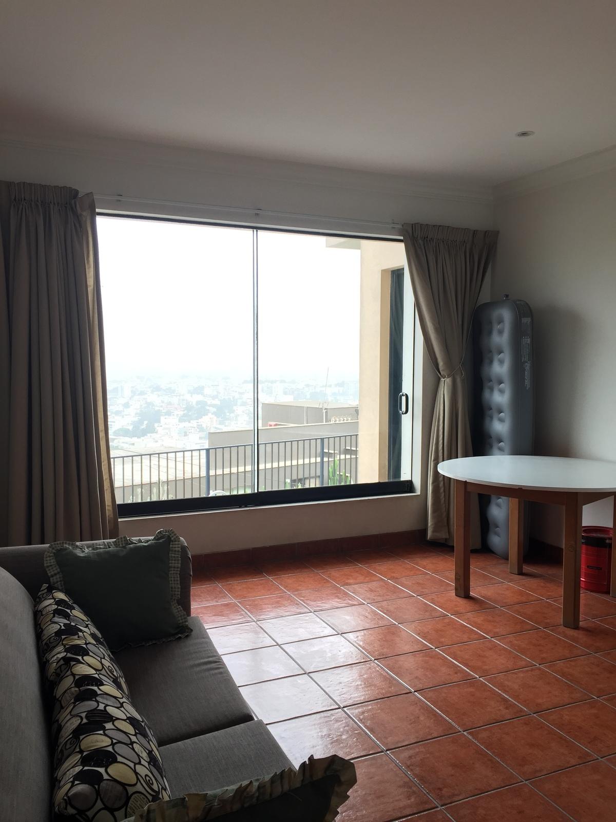 18 de 21: Dormitorio secundario con vista a la terraza